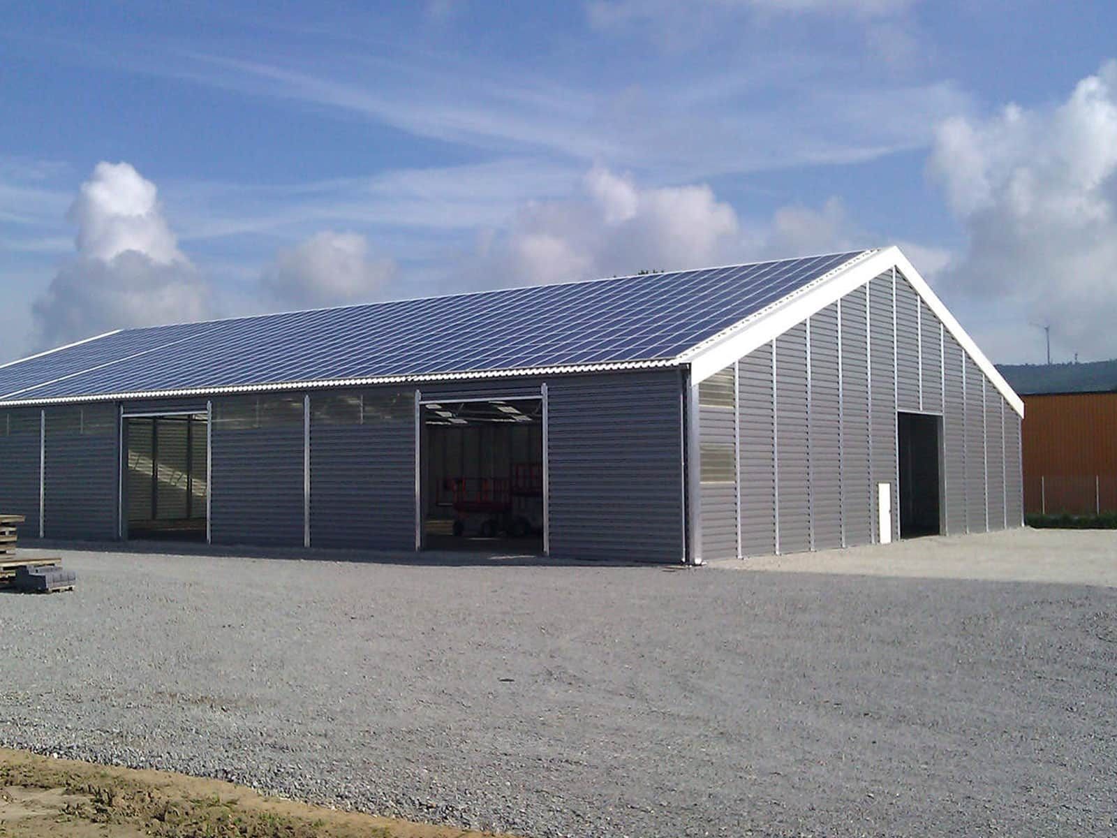 Steel roofed temporary buildings temp re build ltd for Steel barn structures